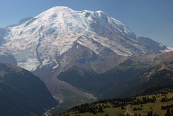 The Emmons Glacier (upper left) dominates the northeast face of Mount Rainier in the view from the subalpine meadows of Sunrise (lower right).