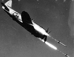 Republic P-47D-40-RE 44-90386 in flight firing rockets