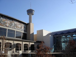 The Henry B. González Convention Center and Lila Cockrell Theater along the San Antonio River Walk.  The Tower of the Americas is visible in the background.