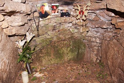 Memorial items, including a Thor's hammer pendant, in the chamber of Stoney Littleton Long Barrow in Somerset, 2015