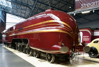 Preserved British steam locomotive of the former London, Midland and Scottish (LMS) Railway, Princess Coronation Class No. 6229 Duchess of Hamilton, 6 June 2009. The locomotive was built as a streamliner in 1938, and was exported to the United States (painted as Class sister No. 6220) for a 3,000-mile tour and visit to the 1939 New York World's Fair, before returning in 1942. The streamlining was removed in 1947 for ease of maintenance. The locomotive was re-streamlined in 2009 and displayed at the National Railway Museum in York.
