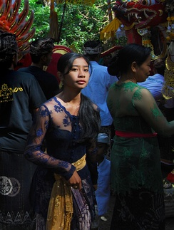 A Native Indonesian Balinese girl wearing kebaya during a traditional ceremony.
