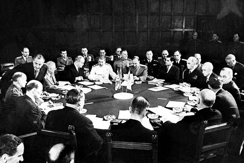 Potsdam Conference session including Clement Attlee, Ernest Bevin, Vyacheslav Mikhailovich Molotov, Joseph Stalin (white uniform), William D. Leahy, Joseph E. Davies, James F. Byrnes, and Harry S. Truman (right)