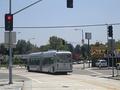 Orange Line bus on the busway crossing Burbank Boulevard and Fulton Avenue.