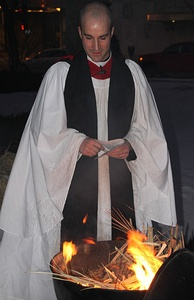 A deacon burning palm fronds from the previous Palm Sunday for Ash Wednesday