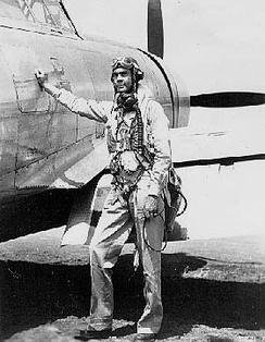 Col. Benjamin O. Davis, Jr., commander of the Tuskegee Airmen 332d Fighter Group, in front of his P-47 Thunderbolt in Sicily
