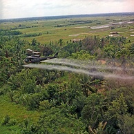 U.S. helicopter spraying chemical defoliants in the Mekong Delta, South Vietnam, 1969