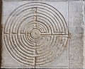 Chartres pattern as a wall maze in Lucca Cathedral, Italy (12th–13th century)