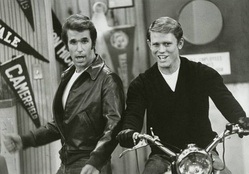 Richie (Ron Howard) takes a turn on Fonzie's motorcycle in a scene from Happy Days