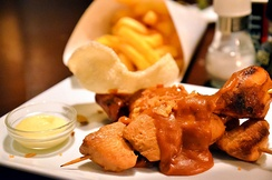 Kipsate met friet, Dutch take on Indonesian chicken satay, served with Peanut sauce, fried onions, kroepoek, friet, and mayonnaise.