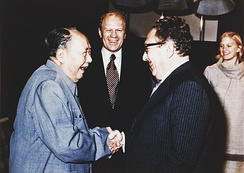 Ford and his daughter Susan watch as Henry Kissinger (right) shakes hands with Mao Zedong, December 2, 1975