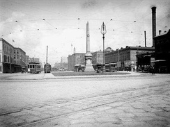 The monument in its original location on Canal Street, 1906