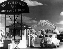 McChord Main Gate in the late 1940s or early 1950s. Mount Rainier is in the background.