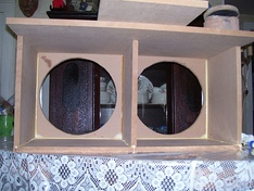 Medium density fiberboard is a common material out of which loudspeaker enclosures are built.
