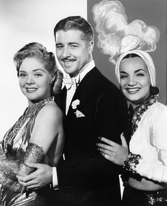 Alice Faye as Baroness Cecilia Duarte, Don Ameche as Larry Martin and Baron Manuel Duarte, and Carmen Miranda as Carmen in That Night in Rio, produced by Fox in 1941