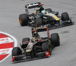 The season started with controversy when two teams using the Lotus name were entered onto the grid, Lotus Renault GP (foreground) and Team Lotus (background).