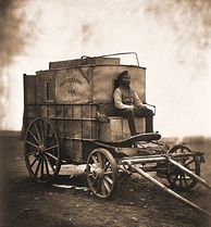 Roger Fenton's Photographic Van, 1855, formerly a wine merchant's wagon; his assistant is pictured at the front.