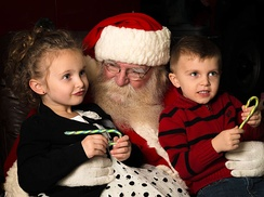 The modern portrayal of Santa Claus frequently depicts him listening to children's Christmas wishes.