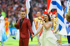 "Soprano Aida Garifullina and pop singer Robbie Williams singing ""Angels"" at the opening ceremony"