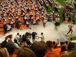 Syracuse Orange football team entering the Carrier Dome.