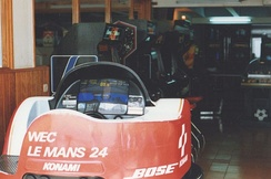 A WEC Le Mans 24 (Konami, 1986) machine along some classic, upright arcade machines