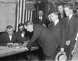 Young men at the first national registration day held in association with the Selective Service Act of 1917.