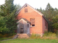 Some of the historical one-room schools that survive today remain unrestored, and in disrepair. The one pictured is located on private land in Price County, Wisconsin, and remains unrestored, despite community interest in preserving it.