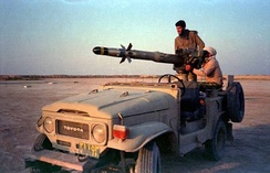 Two Iranian soldiers with a BGM-71 TOW mounted on a jeep during the Iran-Iraq war.