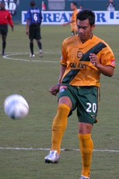 Carlos Ruiz wearing Galaxy's old gold-and-green uniform in 2004