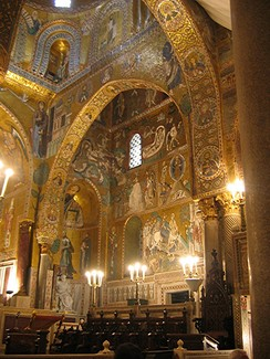 """The Cappella Palatina, at Palermo, the most wonderful of Roger's churches, with Norman doors, Saracenic arches, Byzantine dome, and roof adorned with Arabic scripts, is perhaps the most striking product of the brilliant and mixed civilization over which the grandson of the Norman Trancred ruled"" (from 1911 Encyclopædia Britannica)."