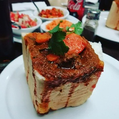 An example of bunny chow served in Durban, originated within the Indian South African community[237]