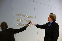 Ed White III touches his father's name engraved in the Space Mirror Memorial at the KSC Visitor Complex.