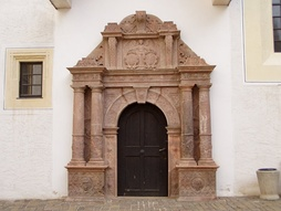 "The rhyolitic tuff portal of the ""church house"" at Colditz Castle, Saxony, designed by Andreas Walther II (1584), is an example of the exuberance of Antwerp Mannerism"