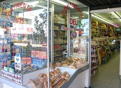 Deli window displaying breads and other foods
