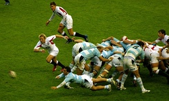 IRB Hall of Fame member Agustín Pichot passes the ball from the back of a scrum.