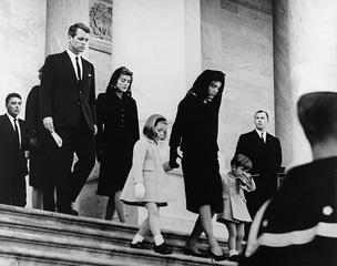 Robert F. Kennedy and Patricia Kennedy Lawford following Jacqueline Kennedy as she leaves the United States Capitol with John F. Kennedy Jr. and Caroline Kennedy, after viewing John F. Kennedy lying in state.
