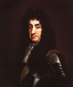 Head and shoulders portrait of Charles with heavy jowls. He wears a wig of long black curls and a suit of armour.