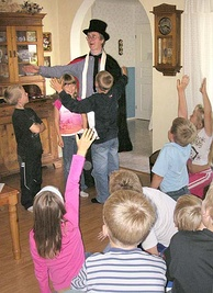 "Amateur magician performing ""children's magic"" for a birthday party audience"