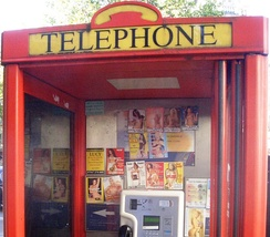 Tart cards in a British phone box advertising the services of call girls