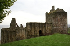Ravenscraig Castle, showing the large D-plan west tower and the ruined east tower