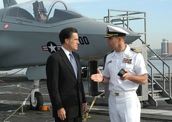 Governor Romney received a tour of the aircraft carrier USS John F. Kennedy on May 20, 2005 as part of celebrating Armed Forces Day