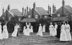Women in England playing netball on a grass court, 1910