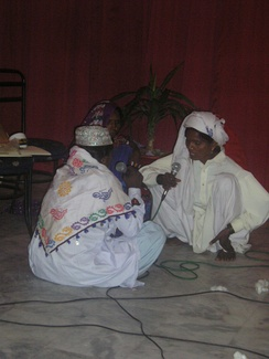 A trio of Pakistani folk singers performing at a local gathering