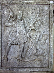 War scene of the Tropaeum Traiani (c. 109 AD): a Roman legionary fighting with a Dacian warrior, while a Germanic warrior (Bastarnae?), who has a suede knot, is wounded on the ground.