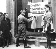 (Top) SA members enforce a boycott of Jewish stores, 1 April 1933(Bottom) Troop inspection in Berlin of the Leibstandarte SS Adolf Hitler, 1938