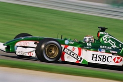 The Jaguar R3 being driven by Eddie Irvine in 2002.