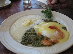 Eggs Sardou with gulf shrimp added and grits on the side