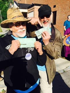 Cromwell and J.G. Hertzler show their arrest citations at the Crestwood station protest.