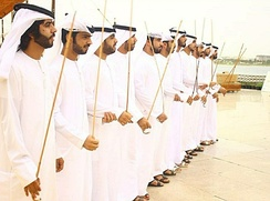 A band performs a razfah in an Emirati wedding. Razfah is a cultural dance derived from Arab tribes sword battles.