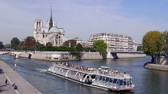 A view of the Seine, the Île de la Cité and a Bateau Mouche